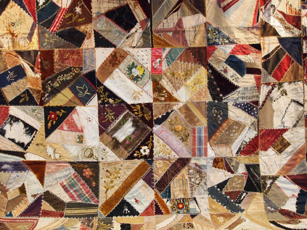 Crazy quilt featuring velvet, silk, embroidery and hand-painted flowers, given to Mr. & Mrs. A.A. Methner of Little Falls, MN, by Mrs. Louise Evans of Fargo, ND. The quilt, made in 1893, is believed to have been made by a member of Mrs. Evans' family. MCHS Collections #1975.40.1.