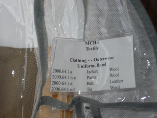 When putting items away, we have to match up the accession number on the item with its storage container. This is the garment bag for the uniform jacket in the picture above. January 20, 2010.