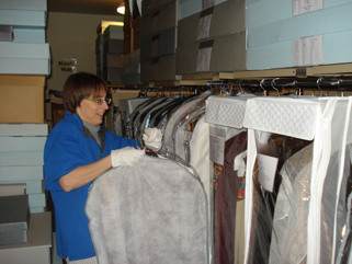 Me - putting away the band uniforms in Collections Room 1. January 20, 2010.