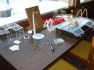As I dismantled the exhibit, I put the exhibit furniture on one table .... January 20, 2010.