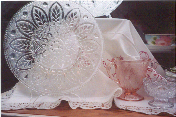 A sample of Depression Glass pieces in the Morrison County Historical Society collections. This photo was taken of a past display at the Weyerhaeuser Museum, copyright 2003, Morrison County Historical Society.