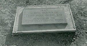 Hole-in-the-Days marker, as placed by the Morrison County Historical Society and the Little Falls Granite Works in 1938. This marker was damaged by vandals in June 2006. Photo from the collections of the Morrison County Historical Society.