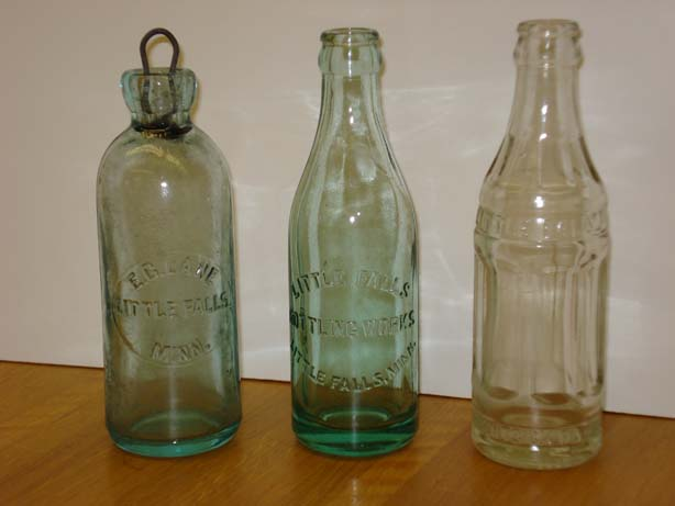 Bottles from the Little Falls Bottling Works in the collections of MCHS.  The left one is an E. C. Lane bottle with a metal and rubber cork.  It appears to be hand-blown.  The others are later models. Photo by Mary Warner, August 29, 2007.