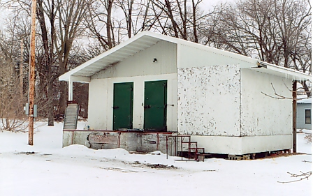 Oak Grove Dairy milk transfer station, corner of Sixth Street & Third Avenue NE, Little Falls, Minnesota.  Demolished between April 10 & 11, 2007.  Photo by Mary Warner, March 2003.